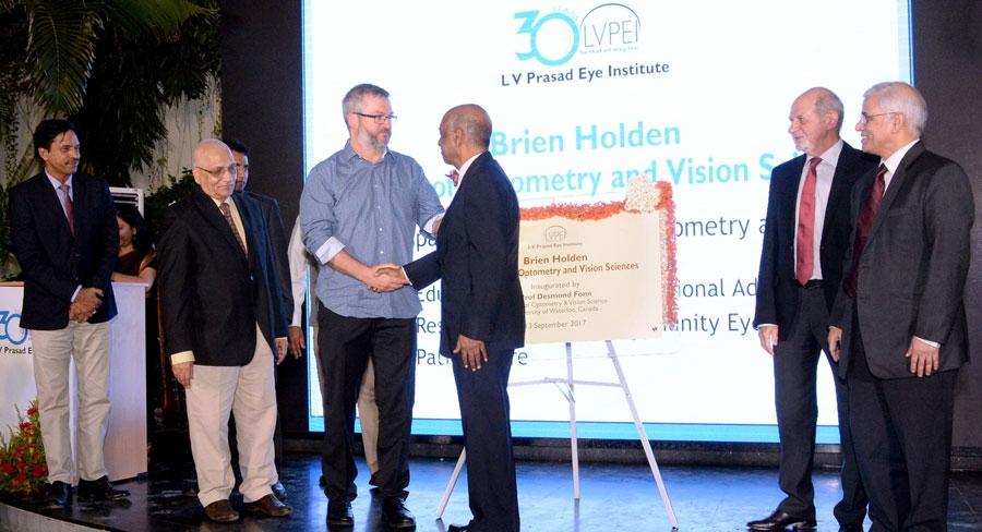Daniel Holden and Dr Nag Rao shaking hands