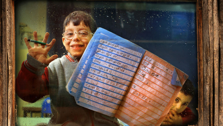 Boy-with-glasses-and-a-book