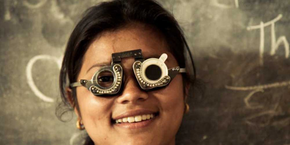 Young woman during visual acuity testing at an eye screening camp in Nepal' {hot by Ellen Crystal, Seva Canada