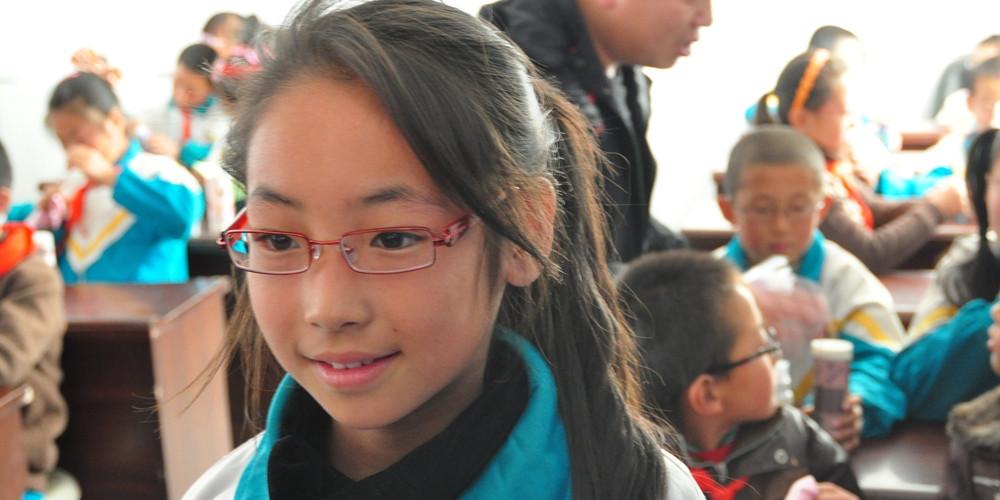 Glasses girl classroom background
