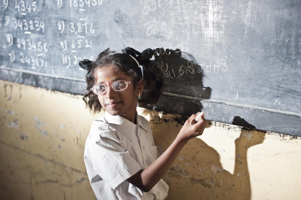 School girl writing on the board