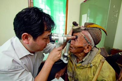 Dr. Lobsang with a patient