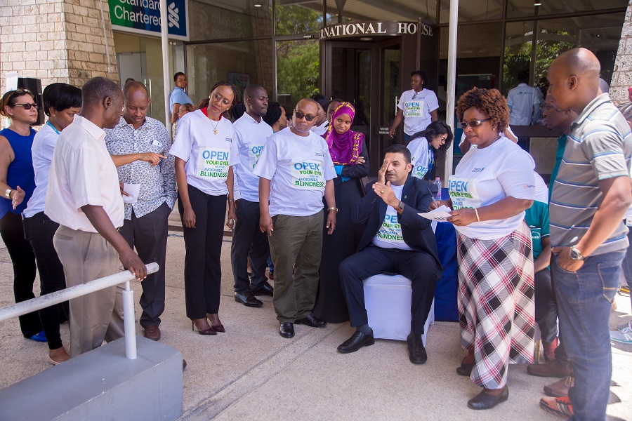 Mr. Sanjay Rughani (CEO) Standard Chartered Bank Tanzania having his visual acuity tested during the screening of SCB staff.