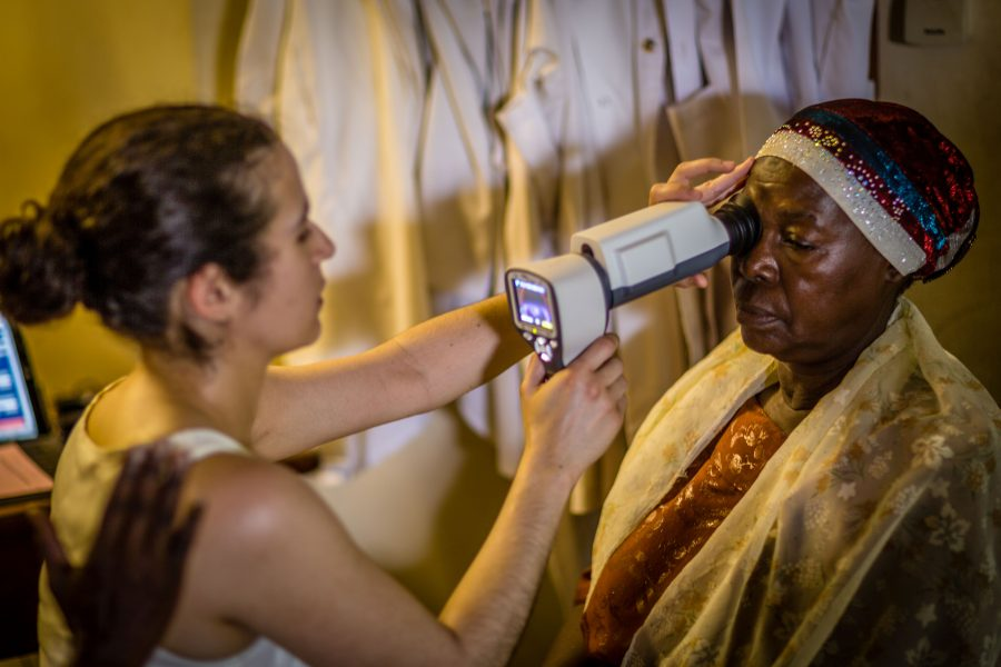 A patient has a fundus photo taken by retinal nurse, Sofia Mendonca using a portable fundus camera, the Pictor Plus / Photo courtesy: Terry Cooper