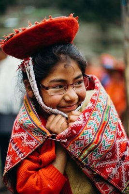 A Peruvian girl celebrates her new glasses with a smile