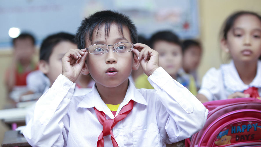 A child surprised to see clearly after wearing new glasses by Nguyen Thi Quynh Nhu
