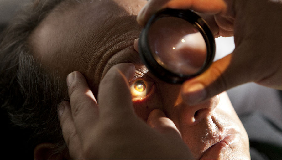 A diabetic retinopathy patient in volunteer faculty Dr. John Carter's vitreo retinal clinic is examined on Screening Day at the Regional Institute of Ophthalmology