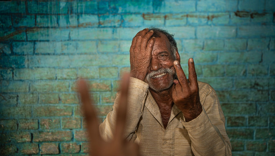 A man smiles as he gets his eyes tested