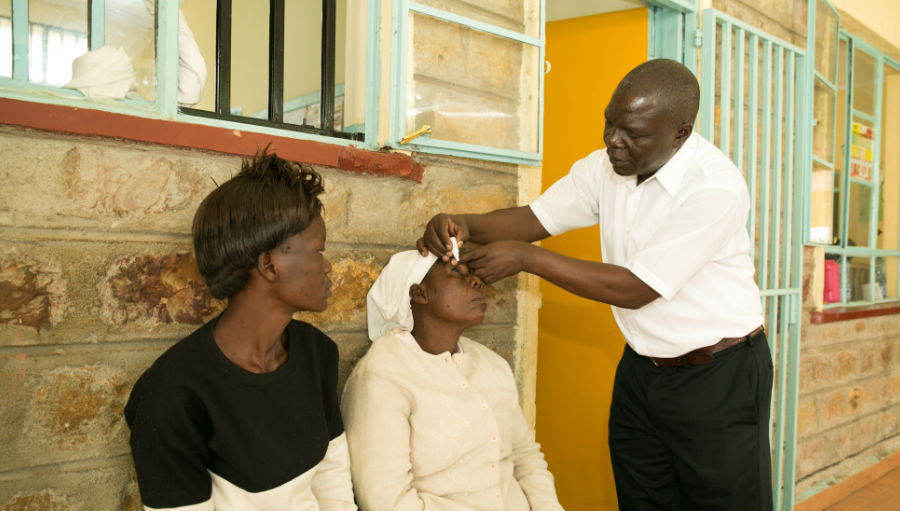 Moses Administering eye drops/ Story: Eye Care and the Role of Nursing in Kenya