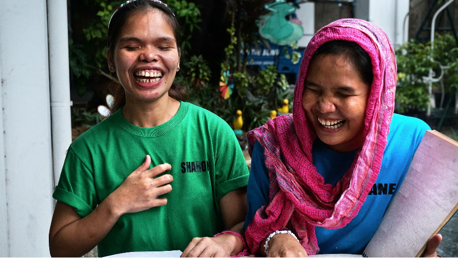 Two girls who are blind reading a braille book/ Story: 2018 in Review: Global Advocacy