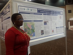 Agnes stands next to Operation Eyesight's poster presentation at the IAPB's 10th General Assembly in Durban, South Africa. Agnes was sponsored by SiB to attend the assembly, in recognition of her exemplary work in bringing eye care services to the people of Elgeyo-Marakwet County