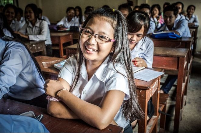 Young school going girl wearing spectacles smiling