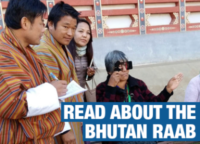 An image from the Bhutan RAAB of surveyors screening an old lady