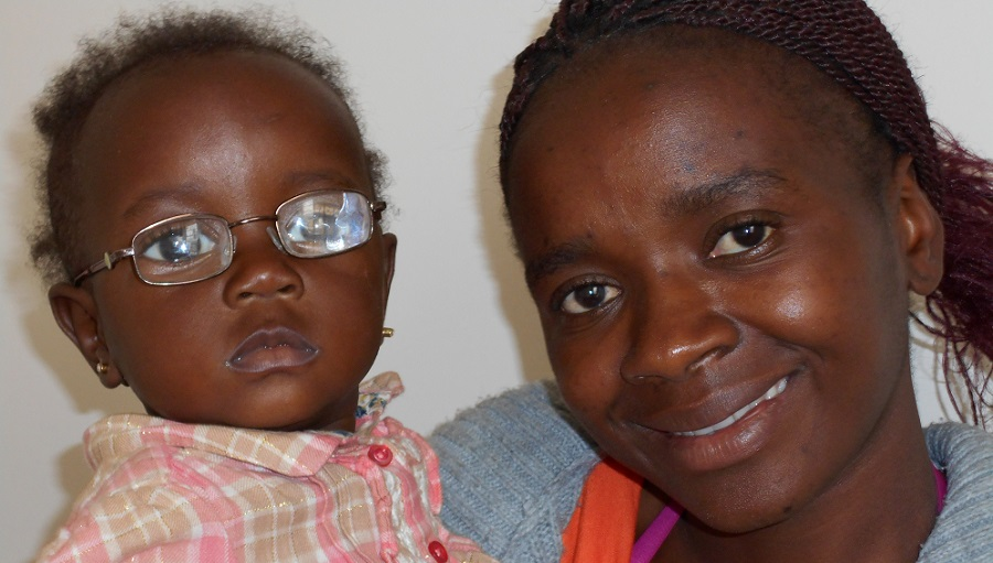Mother with daughter. Daughter has received pair of spectacles though CBM Zimbabwe project.