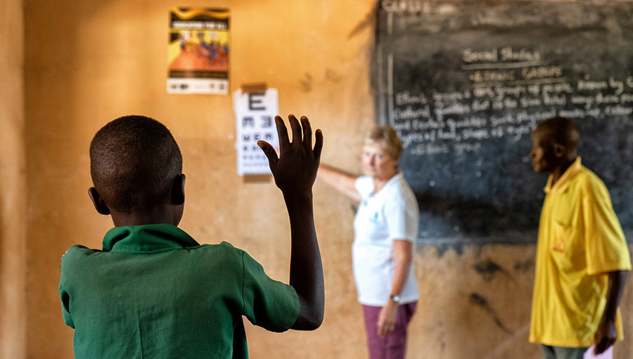 Child indicating the direction of a letter whilst screening at a school in Sierra Leone