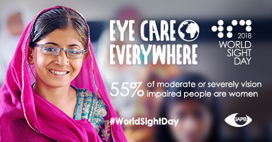 55% of moderate or severely impaired people are women. In the background: Smiling young girl wearing glasses standing in her classroom