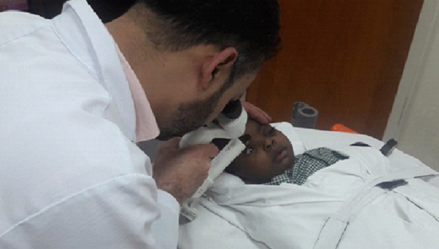 Examining a child with congenital glaucoma
