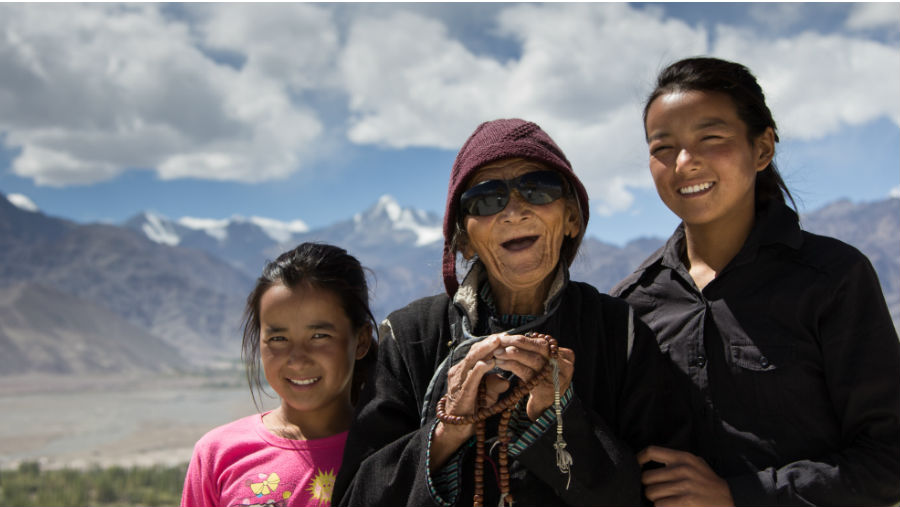 A woman's whose eye sight was restored with her two granddaughter
