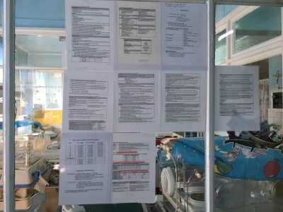 Clinical guidelines attached to walls on the unit