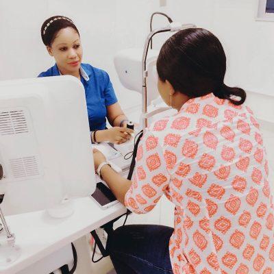 A nurse examines a patient