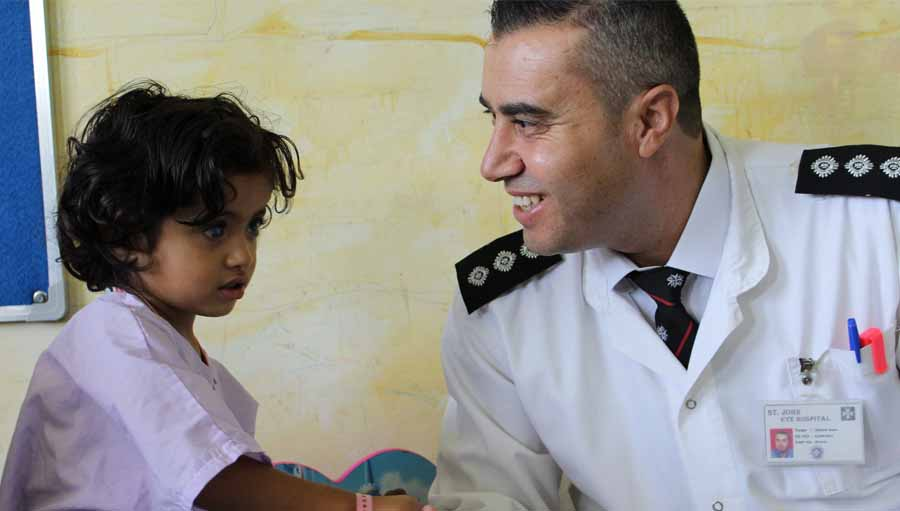 Day in the life of a Nurse Manager. Photo: Two year old Rimas holds hands with nurse Ahmed Amer; Submitted by: Marie-Claire Boyle; St John of Jerusalem Eye Hospital