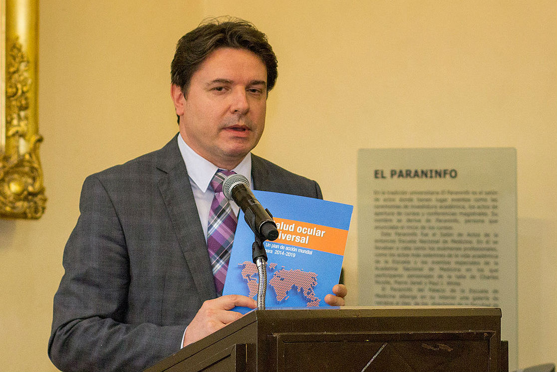 Dr Ivo Kocur, WHO holding a Spanish version of the Global Action Plan document; WSD Mexico event 2014