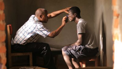 Jerome screens a patient/Copyright: Sightsavers