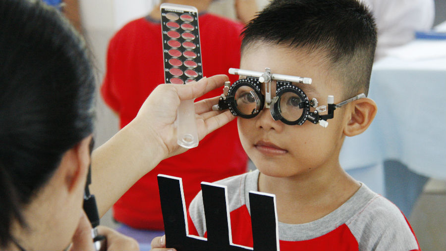 A child gets his eyes tested