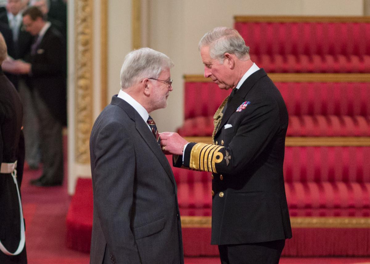 Dr Adrian Hopkins invested with MBE