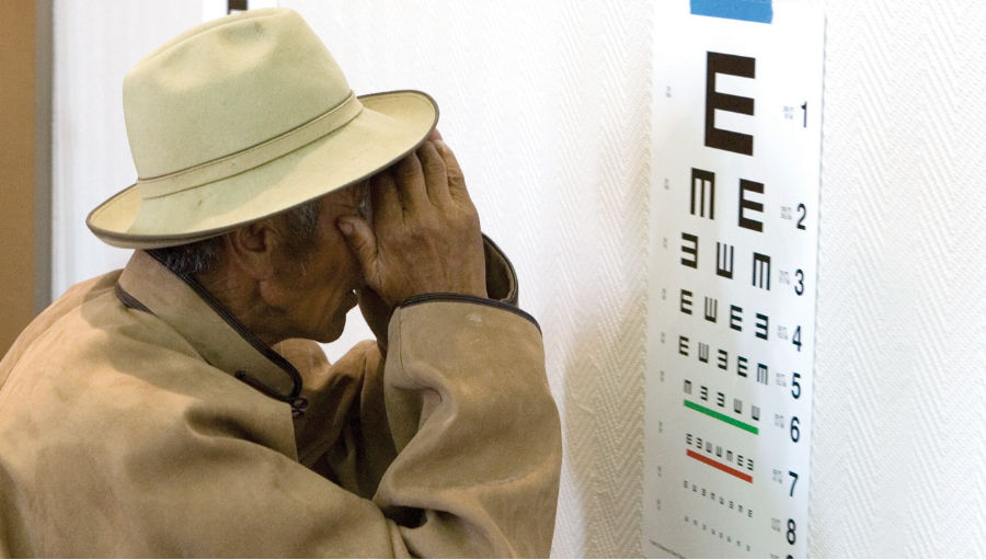 Man checking his eyesight