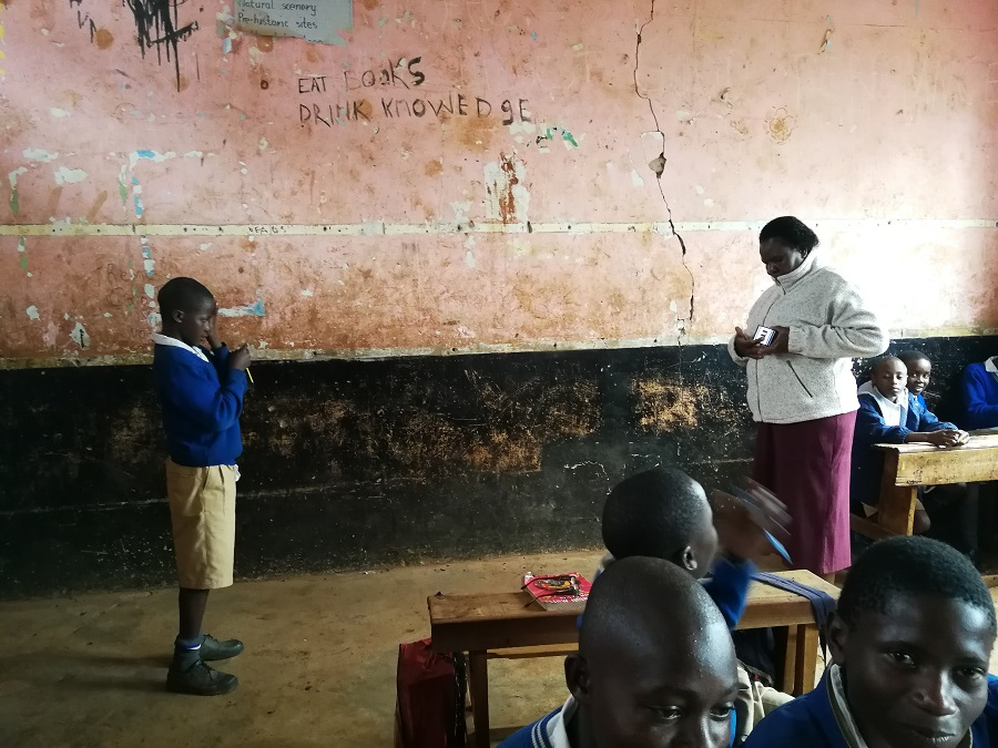 Meshack is screened by his teacher, using the Peek app.