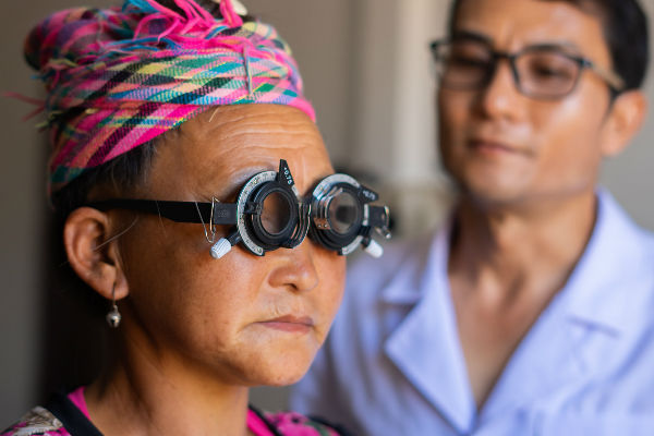 Optometrist and ophthalmic nurse Khamthan Amath looks for the right prescription for Pa, Lao PDR—by Aildrene Israel Tan