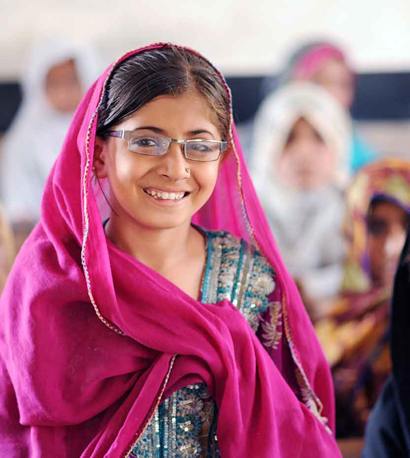 Young girl with glasses in a classroom