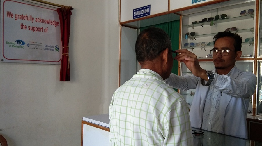 A patient is fitted for spectacles in the Sarupathar Vision Centre in the Assam state of India.
