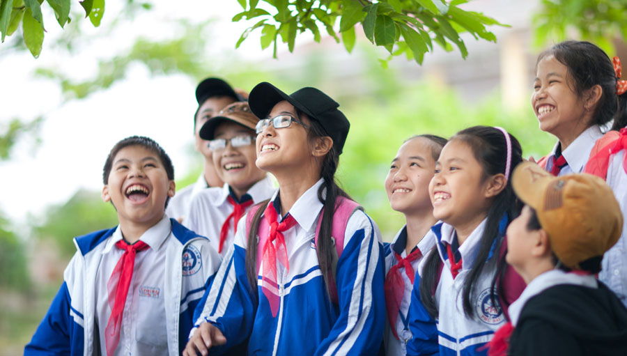 Group of children looking up at trees and smiling Submitted by: Hanh Pham Country: Vietnam Organisation: Orbis International in Vietnam
