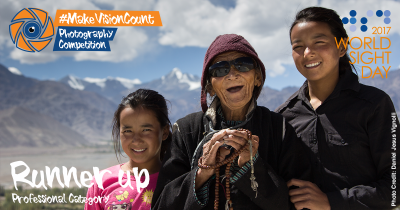 Elderly lady with her grand daughters with the Himalayas in the background