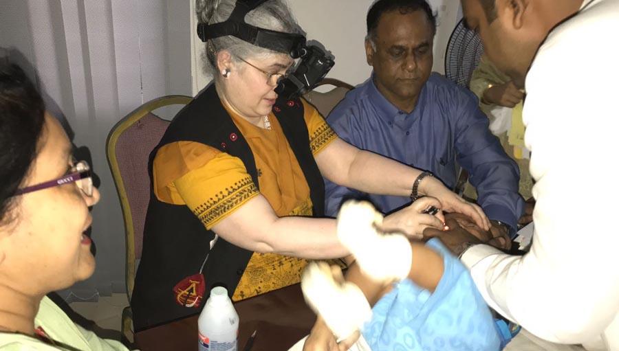 Dr Subhadra Jalali, examining the eye of a newborn