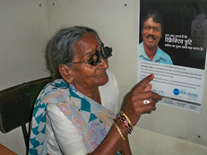 Old woman getting her eyes checked; Sightsavers, SiB