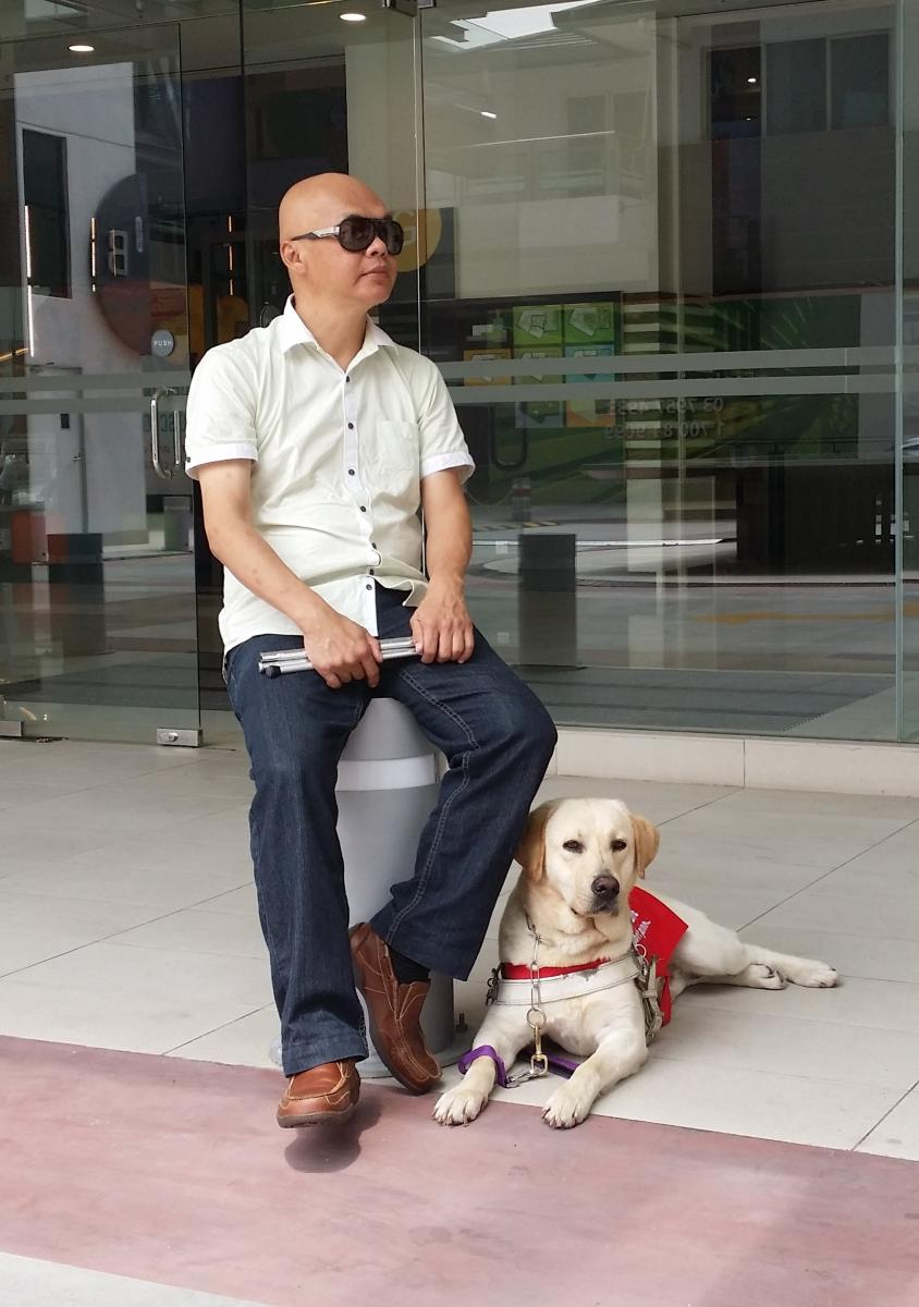 Stevens Chan with his guide dog