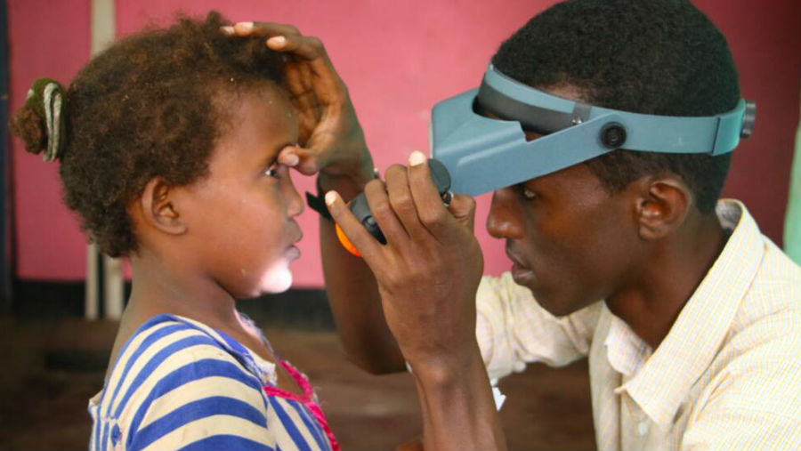 Achieving universal health coverage - how the global trachoma elimination programme is taking us a step closer/ Image: Girl being examined for trachoma