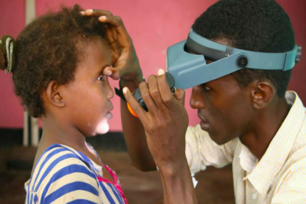A young girl is examined for Trachoma