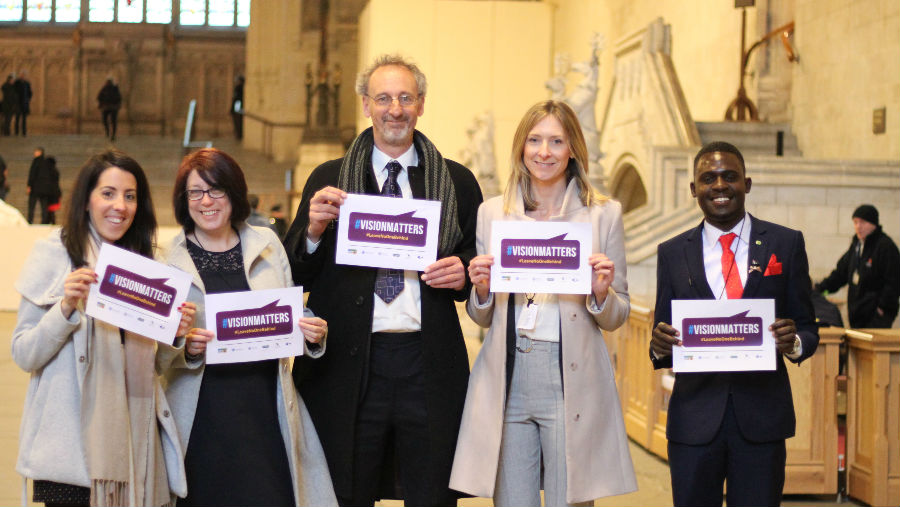VAO hosts call to action event at House of Commons, London/At House of Commons, holding placards of VisionMatters