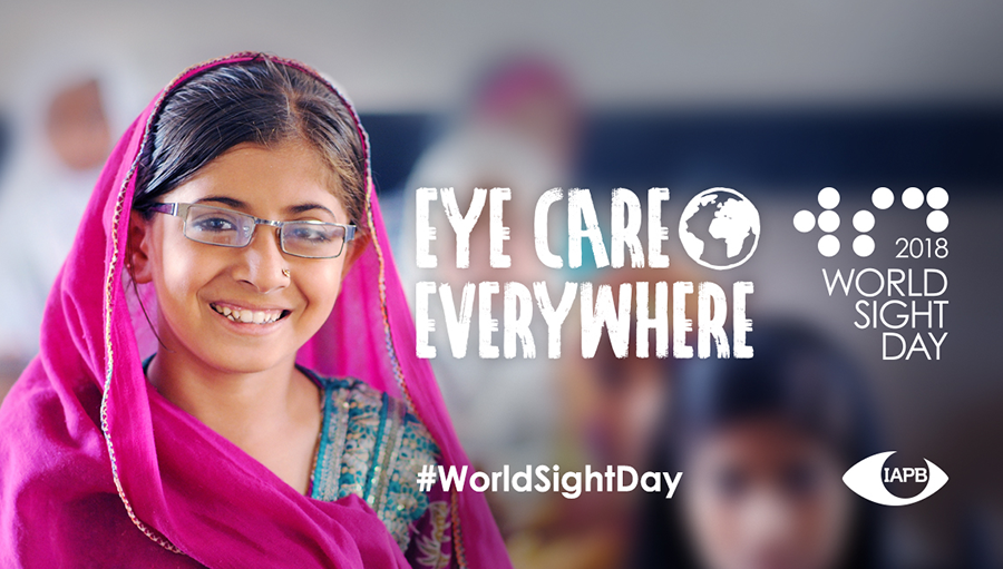 Photo of young girl with glasses smiling in class. World Sight Day 2018 - Eye care everywhere