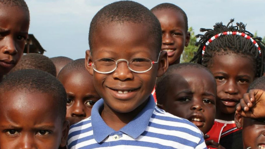 The Effectiveness of Glasses in Rural Burkina Faso/ A boy wearing OneDollarGlasses