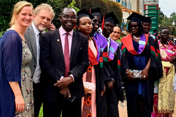 With the happy graduates in Uganda