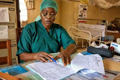 Fatamata Keita, maternity nurse, Sierra Leone can now see to do her paper work