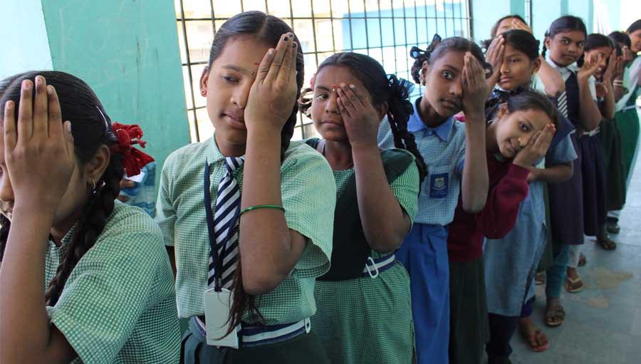 Practising for vision test in school.
